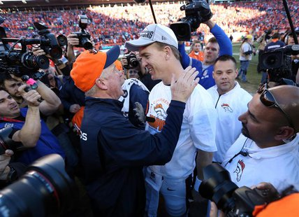 Jan 19, 2014; Denver, CO, USA; Denver Broncos head coach John Fox and quarterback Peyton Manning (18) celebrate after the 2013 AFC champions