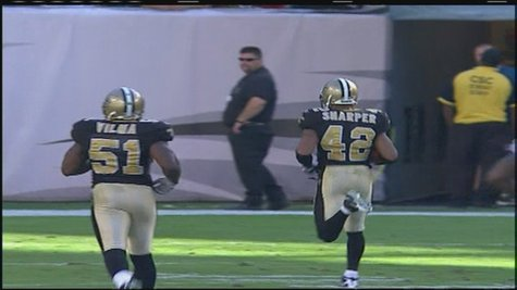 Darren Sharper returns an interception for a touchdown while a member of the New Orleans Saints. The former NFL player was arrested Friday on suspicion of rape. (Photo from: FOX 11).