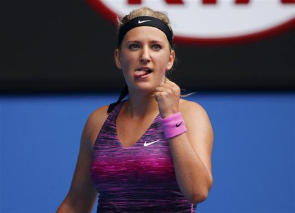 Victoria Azarenka of Belarus celebrates defeating Sloane Stephens of the U.S. during their women's singles match at the Australian Open 2014
