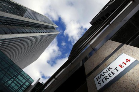 A sign for Bank Street and high rise offices are pictured in the financial district Canary Wharf in London in this October 21, 2010 file pho