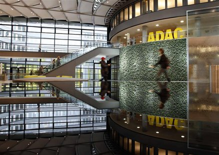 People walk inside the ADAC headquarter in Munich January 20, 2014. REUTERS/Michaela Rehle