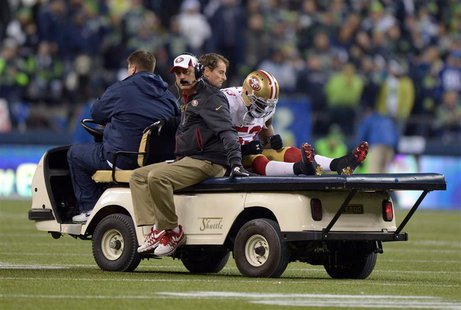 Jan 19, 2014; Seattle, WA, USA; San Francisco 49ers inside linebacker NaVorro Bowman (53) is carted off the field after an injury against th