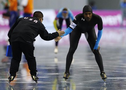 Shani Davis (R) of the U.S. reacts after the men's 1,000m event at the ISU World Sprint Speed Skating Championships in Nagano, central Japan