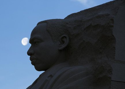 The moon sets over the Martin Luther King, Jr. Memorial during celebrations of the birthday of the civil rights leader in Washington January