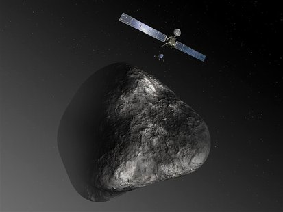 An artist's impression handout image by the European Space Agency shows the Rosetta orbiter deploying the Philae lander to comet 67P/Churyum