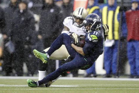 Jan 11, 2014; Seattle, WA, USA; Seattle Seahawks wide receiver Percy Harvin (11) catches a pass against New Orleans Saints cornerback Corey