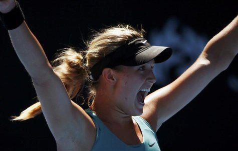 Eugenie Bouchard of Canada celebrates defeating Ana Ivanovic of Serbia in their women's quarter-final tennis match at the Australian Open 20