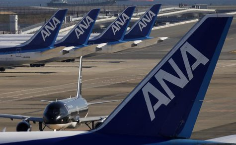 Four All Nippon Airways' (ANA) Boeing Co's 787 Dreamliner planes (top) are seen behind another ANA plane at Haneda airport in Tokyo January