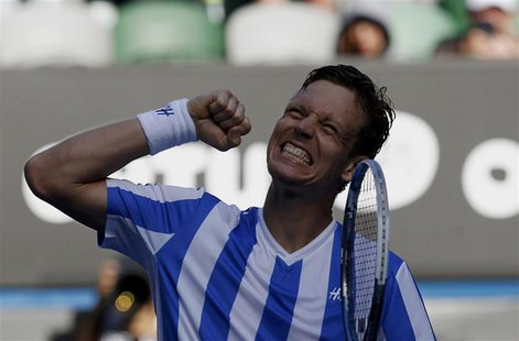 Tomas Berdych of the Czech Republic celebrates defeating David Ferrer of Spain in their men's singles quarter-final tennis match at the Aust