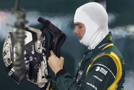 Caterham Formula One test driver Giedo van der Garde of Netherlands puts on his helmet during the first practice session of the Indian F1 Gr