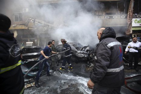 Firefighters extinguish a fire at the site of an explosion in the Haret Hreik area, in the southern suburbs of the Lebanese capital Beirut J