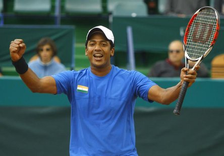 India's Mahesh Bhupathi celebrates after he and his teammate Leander Paes (unseen) won the Davis Cup doubles tennis match against Romania's