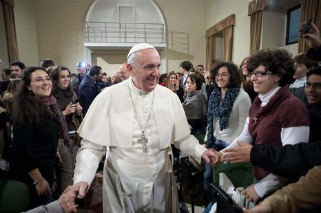 Pope Francis (C) is greeted during a pastoral visit at the Sacro Cuore Basilica in downtown Rome January 19, 2014. REUTERS/Osservatore Roman