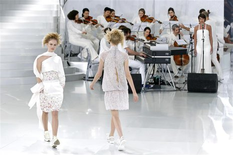 Models present creations by German designer Karl Lagerfeld for French fashion house Chanel as part of his Haute Couture Spring/Summer 2014 f