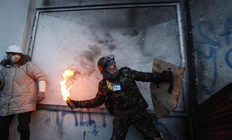 A pro-European integration protester throws a Molotov cocktail towards riot police during clashes in Kiev January 20, 2014. REUTERS/Vasily F