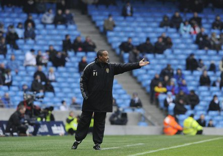 Notts County's coach Paul Ince reacts during their FA Cup soccer match against Manchester City at Manchester, northern England February 20,