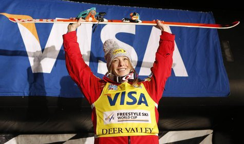 Jan 11, 2014; Park City, UT, USA; First place finisher Hannah Kearney of the United States takes the podium after women's FIS World Cup mogu