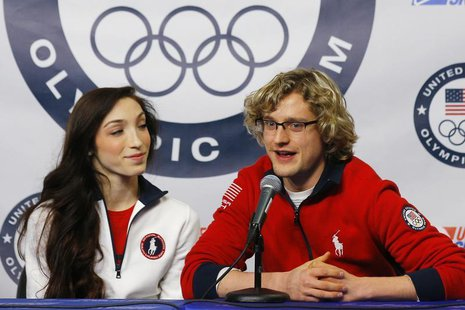 Ice dancing pair Meryl Davis (L) and Charlie White are introduced as part of the United States' team for the upcoming Sochi Winter Olympics,