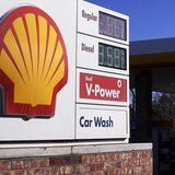 The Shell logo sign is seen at one of its gas station next to the current fuel prices display in Westminster, Colorado January 17, 2014. REU
