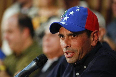 Venezuela's opposition leader and governor of Miranda state Henrique Capriles answers a question during a news conference in Caracas Novembe
