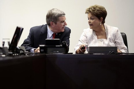 International Olympic Committee (IOC) President Thomas Bach speaks with Brazil's President Dilma Rousseff during a meeting at the Planalto P