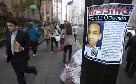 A poster for Avonte Oquendo, a missing 14-year-old autistic child, is seen in downtown New York October 15, 2013. REUTERS/Carlo Allegri