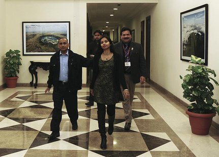 Indian diplomat Devyani Khobragade (C) arrives with her father Uttam Khobragade (L) at Maharashtra Sadan state guesthouse in New Delhi Janua