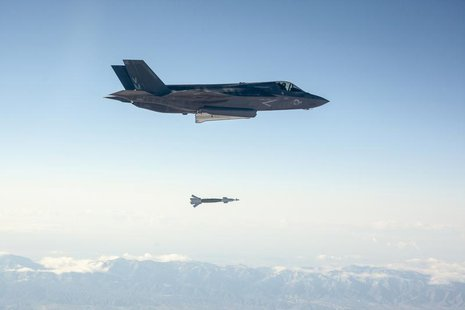 A U.S. Marine Corps F-35B short take-off and vertical landing (STOVL) fighter jet drops a laser-guided bomb during its first guided weapons