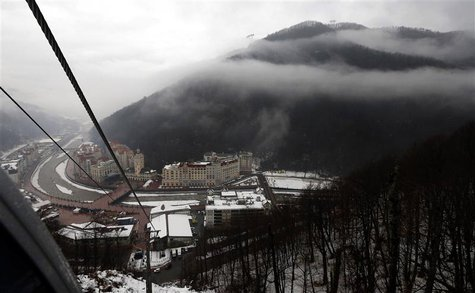The Rosa Khutor Alpine Resort is pictured from the cable car cabin during heavy rain in Krasnaya Polyana near Sochi January 21, 2014. REUTER