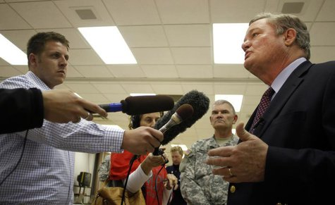 North Dakota Governor Jack Dalrymple (R) speaks with the media at the FEMA Disaster Recovery Center in Minot, North Dakota, June 27, 2011. R
