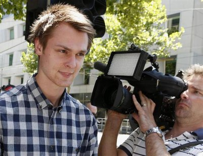 Daniel Dobson, a 22-year-old Briton arrested during an Australian Open 2014 tennis match at Melbourne Park on Tuesday, leaves Melbourne Magi