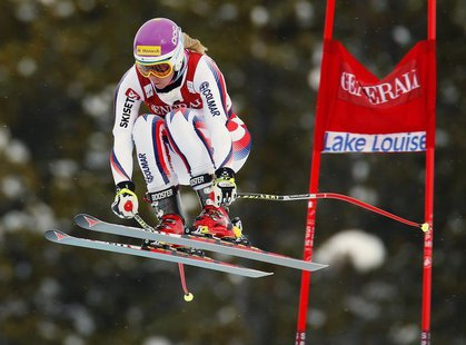 Chemmy Alcott of Britain takes air past a gate during alpine skiing training for the Women's World Cup Downhill in Lake Louise, Alberta, Nov