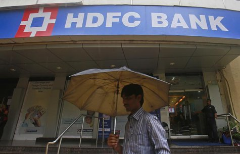A customer walks outside an HDFC Bank branch in Mumbai July 17, 2013. REUTERS/Danish Siddiqui