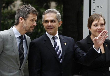 Denmark's Crown Prince Frederik (L) listens to Mexico City's Mayor Miguel Angel Mancera as Denmark's Health Minister Astrid Krag looks on du