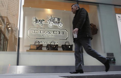 A man walks past a Coach store on Madison Avenue in New York, January 23, 2013. REUTERS/Carlo Allegri