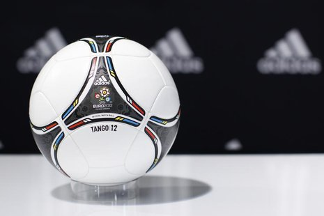 "A ""Tango 12"" soccer ball for the upcoming Euro 2012 soccer tournament is displayed during a news conference at the sporting goods maker Adid"