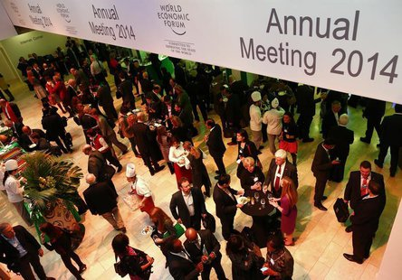 Participants break for lunch between sessions during the annual meeting of the World Economic Forum (WEF) in Davos January 22, 2014. REUTERS