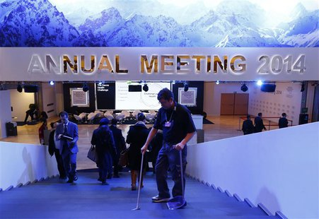 A member of staff cleans a stair inside the congress center before the start of the annual meeting of the World Economic Forum (WEF) 2014 in