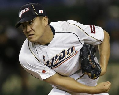 Japan's pitcher Masahiro Tanaka pitches against the Netherlands in the fifth inning at the World Baseball Classic (WBC) second round game in
