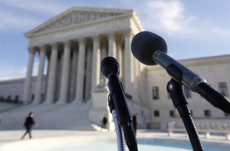 Microphones are set up for attorneys in front of the U.S. Supreme Court after delivering their oral arguments on the first day of a case inv