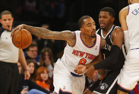 Jan 20, 2014; New York, NY, USA; New York Knicks shooting guard J.R. Smith (8) works against Brooklyn Nets shooting guard Joe Johnson (7) du