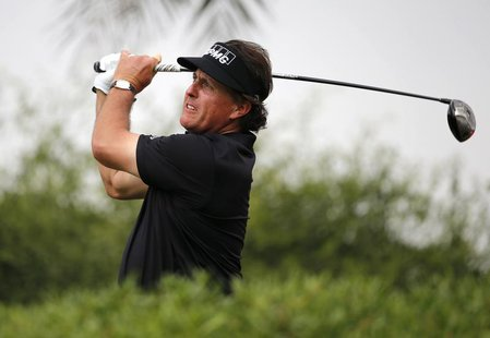 Phil Mickelson of the U.S. tees off on the 11th hole during Abu Dhabi Golf championship January 19, 2014. REUTERS/Ahmed Jadallah