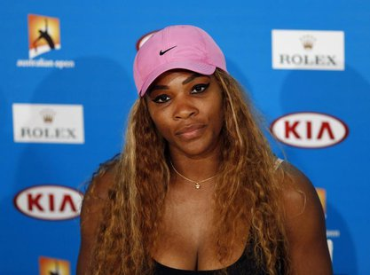 Serena Williams of the U.S. attends a news conference after being defated by Ana Ivanovic of Serbia in their women's singles match at the Au
