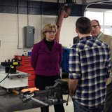 U.S. Senator Tammy Baldwin learns from a student about equipment used at the LTC Wind Energy lab.
