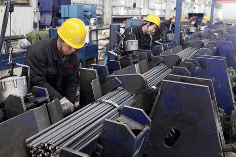 An employee works at a steel factory in Lianyungang, Jiangsu province, December 30, 2013. REUTERS/Stringer