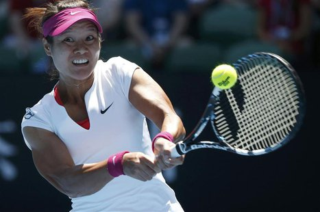 Li Na of China hits a return to Eugenie Bouchard of Canada during their women's singles semi-final match at the Australian Open 2014 tennis