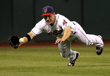 Cleveland Indians Grady Sizemore fails to make a diving catch on a hit by Alex Rodriguez during the ninth inning of the Indians MLB American