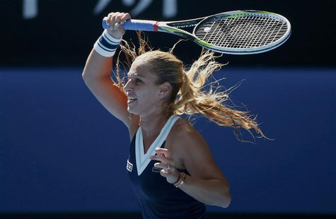Dominika Cibulkova of Slovakia hits a return to Agnieszka Radwanska of Poland during their women's singles semi-final match at the Australia