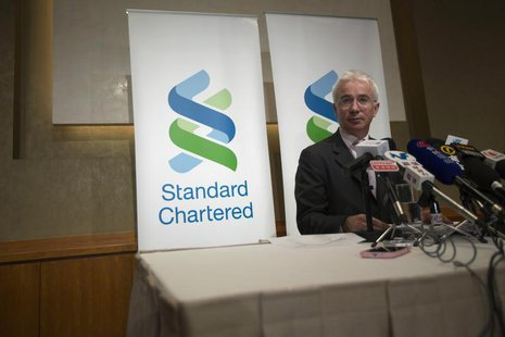 Standard Chartered Group Chief Executive Peter Sands speaks during a news conference in Hong Kong March 13, 2013. REUTERS/Tyrone Siu