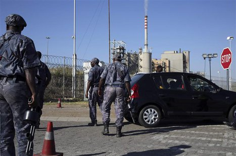 Armed security officers search cars outside the Lonmin mine in Rustenburg, northwest of Johannesburg January 23, 2014. REUTERS/Siphiwe Sibek